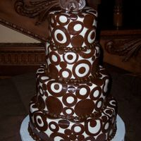 "Godfrey - Eltora Wedding Cake I was so excited to do this cake!!! 4"", 6"", 8"" and 10"" layers. Covered in fondant and brown, fondant circles. When I..."