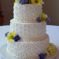 "Nielsen - Bostian Wedding Cake 6"", 8"" and 10"" round lemon pound cake w/french vanilla butter cream filling and icing. Scrollwork is butter cream w/super..."