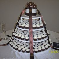 Hinson-Nale Cupcake Wedding Cake I was soooo excited about doing my very first cc wedding cake! 250 mini cupcakes in strawberry, milk chocolate and french vanilla. The...