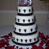 "Geissele - Bideau Wedding Cake 6"", 8"", 10"" and 12"" rounds. Cake is covered in MMF. Decorates are black ribbon, molded fleur-de-lis (in honor of the..."