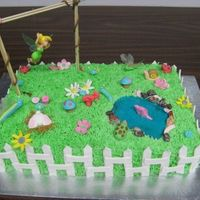 Tinkerbell Garden Cake for my daughter's 6th birthday. Her only request was that Tinkerbell be flying.
