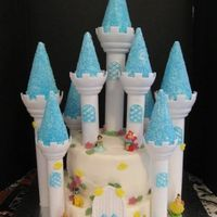 "Princesses Castle Cake for my daughter's 5th birthday. Wilton castle kit. Princesses are from Disney ""Kinder"" Eggs."