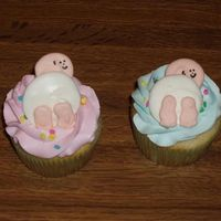 Baby Bottom Cupcakes These are vanilla cupcakes filled with pastry cream and frosted with whipped vanilla buttercream. The decorations were made out of royal...