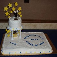 Graduation Cake Vanilla cake frosted with wilton whipped icing mix (their version of whipped cream icing that is stable in warm weather...this cake was for...