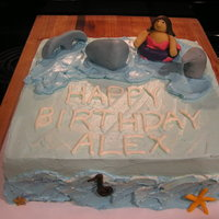 Alex's Birthday Cake I did this cake for my friend's daughter's birthday. She wanted to be swimming with a dolphin or a whale. I think I managed that...