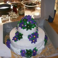 Small Backyard Weding Cake Round cakes (10 and 6in) - White buttercreme and royal icing lilies....