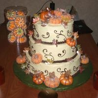 Fall Themed Wedding Cake This cake has has ivory buttercreme icing, chocolate buttercreme border and scroll decor, fondant pumpkins brushed with gold and bronze...
