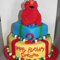 Elmo This cake was for my great niece. Elmo was made out of RKT and piped with royal icing.