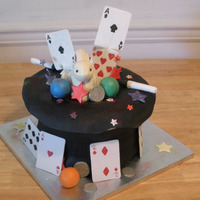 Magic Hat Cake Black magic hat with a rabbit made out of white chocolate, cards and many things use by a magician.