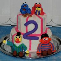 "Sesame Street Birthday Cake! This is a 9 and 6"" layered cake. I used the doctored buttercream dream icing and made a white cake. Everyone at the party loved it,..."