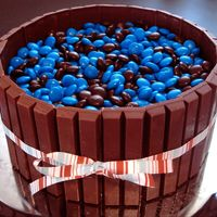 "Kitkat Barrel Cake 2-8"" white cakes with Doctored Buttercream Dream. Covered with what else....kit kat bars and M&M's! This is for my husbands..."