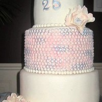 25Th Anniversary Cake All was good and well until I stuck my thumb in to the right hand side of the bottom cake... :(