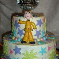 70's Dance Party Here is a cake I did for a 70's dance party... it is white cake with chocolate fudge filling and chocolate fudge cake with chocolate...