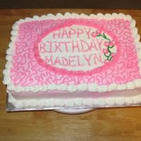Pink Birthday Cake White cake with BC icing. The middle is very off center and I tried to fill it with a vine and flowers which didn't look good. Gotta...
