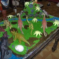 "5Th Birthday Jurrassic Cake  This cake was a joint project with my husband for our daughter's 5th birthday. She wanted a ""Jurrassic Park cake."" She didn..."