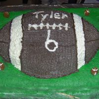 Football Cake  This double layer chocolate cake is with a buttercream frosting for all decoration except for the black which is chocolate store bought...