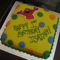 Elmo My son had two birthday parties...this was the second cake I made. My very first attempt at fondant (MMF). It certainly wasn't easy...