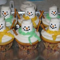 Snowmen Cupcakes Idea from a Wilton yearbook. Buttercream with marshmallow head and pretzel arms