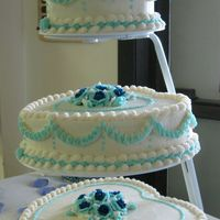 Amanada's Wedding All buttercream, marble inside. Her colors were navy and baby blue.