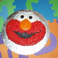 Elmo Cake My twin nephews were very into Elmo so I made them an Elmo birthday cake. I used the Elmo character pan. I don't care for how the star...