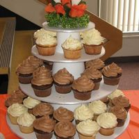 Cupcake Tower This is a cupcake tower I made for an open house wedding reception my husband's family threw for us in his hometown. There was...