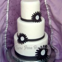 Black And White Daisy Simple design on dummy cake. All fondant.