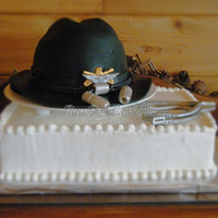 Cavalry Cake White and chocolate cake with chocolate mousse filling. Cavalry hat decorated in fondant with fondant details. This cake was made for a...