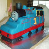 Thomas The Tank Engine In 3D Using Wendy's excellent tutorial, I carved Thomas from an 11x15 sheet cake, stacked and frozen. He is covered in mmf. Face is molded...