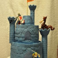 Blue Castle Cake  Made for my son's 8th Kinghts birthday party. Cut out the stones from fondant. The towers are from the Wilton kit, covered in fondant...