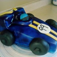 Pinewood Derby Cake  Carved a Cub Scout derby car for my son's blue and gold banquet. Wheels are fondant covered donuts. Covered in fondant that was...
