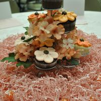 Cupcake Centerpieces  I made 270 of these for an LDS Women's Conference. The flowers were piped in buttercream in peach, coral and pink colors. I was pretty...