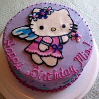 Mia's Hello Kitty Cake White cake with raspberry filling and buttercream. Frozen buttercream transfer for Hello Kitty...and it worked this time! My last 2 didn&#...
