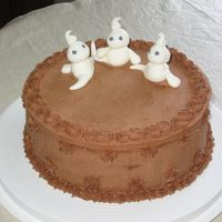 Chocolate Ghost Cake   Just playing around with fondant and thought these little guys were cute.