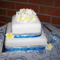 Frangipani Wedding 2 tier banana and choc mud cakes covered with fondant with gumpaste frangipanis.....