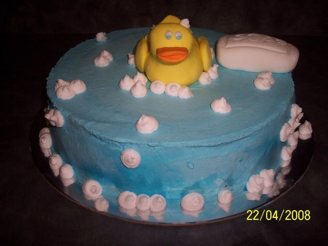 Ducky Bath 10 inch round choc mud cake with buttercream icing. Ducky and soap fondant, bubbles buttercream.....Inspiration drawn from many similar...