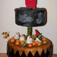 Snoopy's Halloween Bottom tier is the Peanuts gang walking through the pumpkin patch & top tier is Snoopy as the Flying Ace. All fondant, everything...