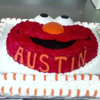 Elmo Decorated in Buttercream Frosting with Chocolate Letters