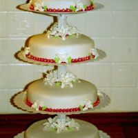 Round Wedding Cakes With some flowers.