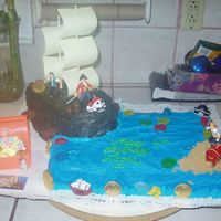 Pirate Ship Cake Here is a picture of the cake that I did for my nephew's 4th birthday. The water was a 9x13 cherry chip cake frosted with buttercream...