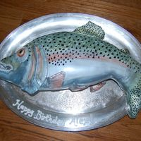 Rainbow Trout Sculpted cake, covered with fondant and painted with luster dust