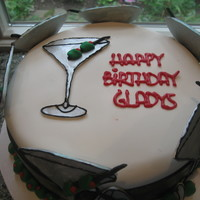 Toast To A Happy Birthday Martini Glasses made out of gumpaste. All other out of fondant