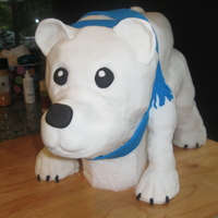 Polar Bear Vanilla Cake with lemon curd and raspberry mousse filing. The arms and legs were made with a mixture of cake and buttercream formed around...