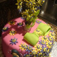 "Garden Birthday Cake 9"" 4-layer chocolate cake covered with fondant, cutout flowers, bow, border and fairies made with gumpaste (sorry i need to work on my..."