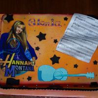 Hanna Montana White Almond Sour Cream Cake covered in MMF with fondant Hanna & Music sheep plaque. Other decorations also fondant and dragees.