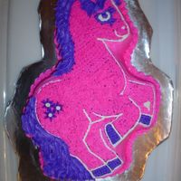"My Precious Pony Cake My daughter loves ""my little pony"" toys, so we chose a chocolate cake with pink and purple frosting for one of her cakes."