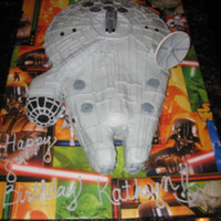 Millenium Falcon - Star Wars My daughter is a huge Star Wars fan so she decided on a Millenium Falcon cake for her 8th birthday. It was a lot easier than I thought it...