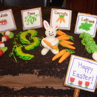 Easter Garden Devil's food cake with cookies and cream filling, chocolate buttercream frosting and crushed Oreos for soil. Fondant carrots and...