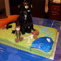 How To Train Your Dragon Lemon cake with lemon buttercream frosting for my daughter's 10th birthday. Toothless is made out of rice cereal treats and covered in...