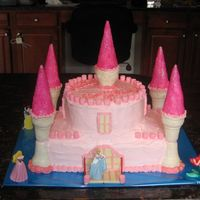 "Princess Juliana's Castle Cake My first attempt at a castle cake. Two 9x13"" on the bottom with two 8"" rounds on top. Towers are sugar cones dipped in white..."