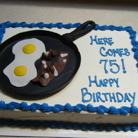 Bacon And Eggs Cake It is a white cake with buttercream frosting and fondant pan, bacon and eggs. He eats bacon and eggs pretty much everyday :).